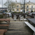 Outside terrace at Brace & Browns with wooden benches and decking area