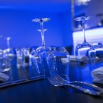 Close-up of glasses and cutlery at Aquila Modern European Restaurant