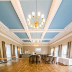 Bath Function Rooms with wooden floor and pale blue ceiling and white beams