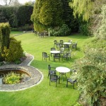 Alveston House gardens with tables and chairs on lawn