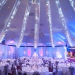 Woodbury Park - tables laid out for party with white table cloths and blue/red lighting
