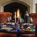 dining with plates of food infront of fireplace